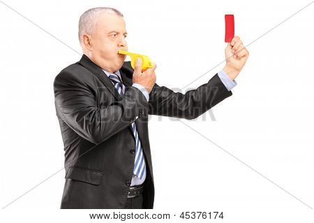 A mature businessman blowing a whistle and showing a red card, isolated on white background