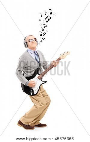 Full length portrait of a middle aged man playing guitar and musical notes around, isolated on white background