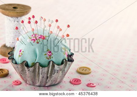 Sewing Concept Background With Floral Pincushion