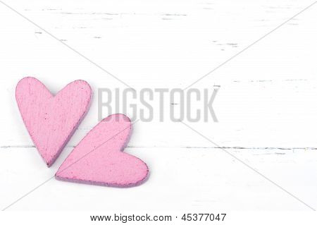 Two Pink Hearts On White Background