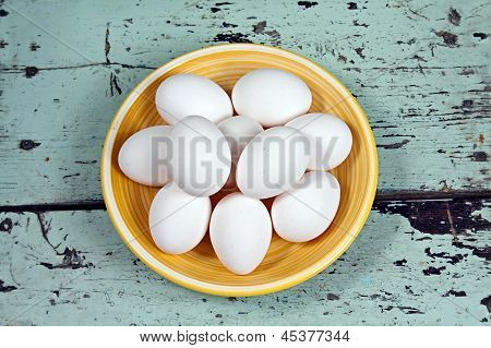 White Eggs On A Yellow Plate