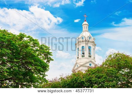 White Church Spire On Blue Cloudy Background