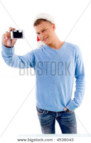 Adult Guy Posing With Christmas Hat And Camera