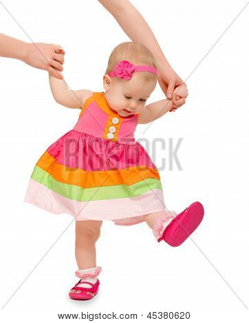 First Steps Of A Beautiful Cute Baby Girl With  Hand Of Mother Isolated