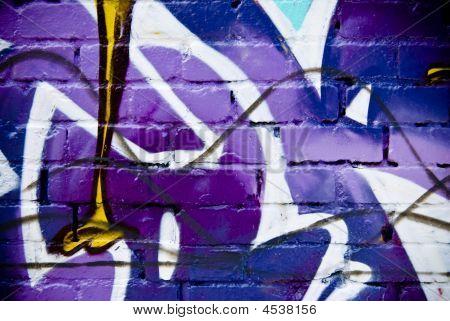 Graffiti Fragmet On The Textured Brick Wall.