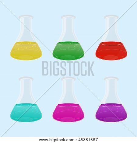 Conjunto de multicor líquido em frascos de laboratório