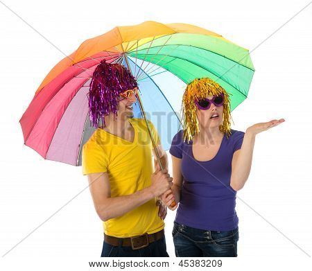 Funny Dressed Couple With Umbrella Looking For Rain