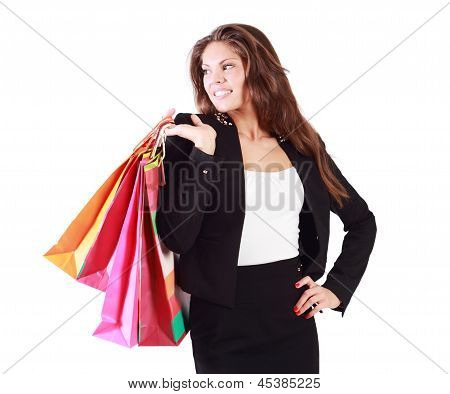 Smiling Woman In Suit Holds Bags And Looks Away Isolated On White Background.
