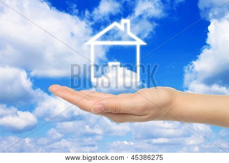 Virtual house with woman hand