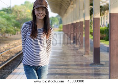 Portrait Of A Beautiful Woman Smiling On Train Station Platform