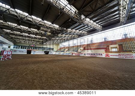 MOSCOW - JUN 9: Indoor riding hall at equestrian center Bitsa, June 9, 2012, Moscow, Russia. Arena size 89,5x37,8 m with a sandy surface.