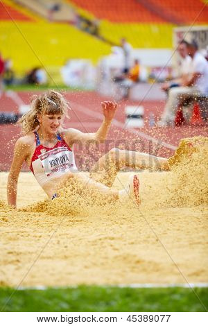 MOSCOW - JUN 11: Anna Krylova in sandpit at Grand Sports Arena of Luzhniki OC during International athletics competitions IAAF World Challenge Moscow Challenge, June 11, 2012, Moscow, Russia.