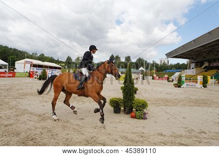 MOSCOW - JUN 9: Participant of international competitions in show jumping CSI3 Vivat, Russia in equestrian center Bitsa, June 9, 2012, Moscow, Russia. Prize fund of the competition was 114 500 euros.