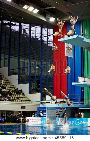 MOSCOW - APR 13: (Serial shots) Athletes jump from tower at competitions on springboard diving in SC Olympic Pool on day of third phase of World Series of FINA Diving, April 13, 2012, Moscow, Russia.