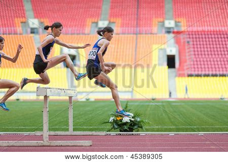 MOSCOW - JUN 11: Serial shot athlete makes a good jump on International athletic competition Moscow Challenge on June 11, 2012 in Luzhniki, Moscow, Russia