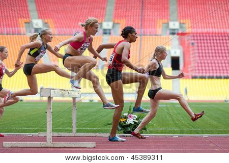 MOSCOW - JUN 11: Women can easily overcome obstacles on International athletic competition Moscow Challenge on June 11, 2012 in Luzhniki, Moscow, Russia