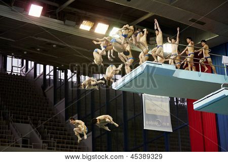 MOSCOW - APR 13: (Serial shots) Athletes jump from diving-tower in Pool of SC Olympic on day of third phase of World Series of FINA Diving, April 13, 2012, Moscow, Russia.