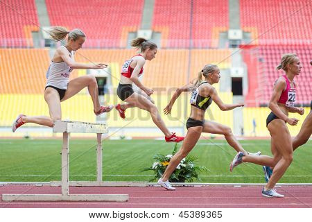 MOSCOW - JUN 11: Women each other overcome obstacle on International athletic competition Moscow Challenge on June 11, 2012 in Luzhniki, Moscow, Russia