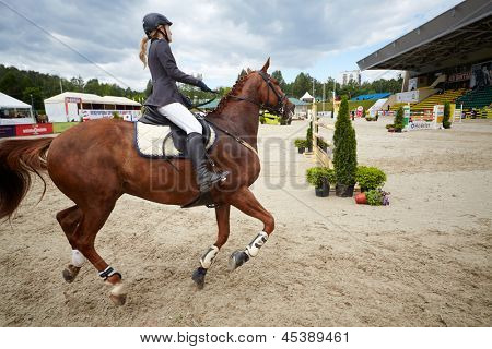 MOSCOW - JUN 9: Rider on horse at competitions in show jumping CSI3 Vivat, Russia in equestrian center Bitsa, June 9, 2012, Moscow, Russia. Prize fund of competition was 114 500 euros.