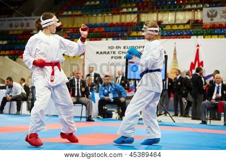 MOSCOW - JUN 9: Female fighters and judges during fight at 10th Team Championship of Europe on karate at OC Luzhniki, Small sports arena, June 9, 2012, Moscow, Russia.