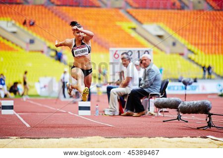 MOSCOW - JUN 11: Female jumper in long jump place at Grand Sports Arena of Luzhniki OC during International athletics competitions IAAF World Challenge Moscow Challenge, June 11, 2012, Moscow, Russia.