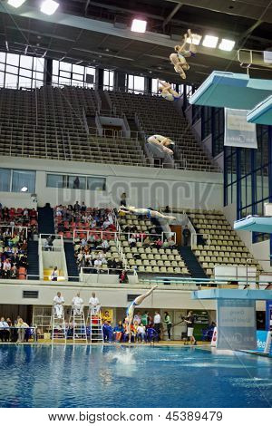 MOSCOW - APR 13: (Serial shots) Female athlete jumps from diving-tower in Pool of SC Olympic on day of third phase of World Series of FINA Diving, April 13, 2012, Moscow, Russia.