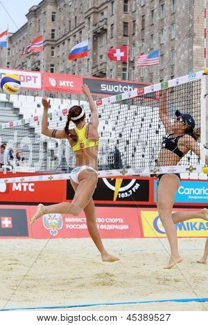 MOSCOW - JUNE 6: Women from Brazil play volleyball in Country Quota at tournament Grand Slam of beach volleyball 2012, on June 6, 2012 in Moscow, Russia.