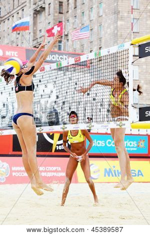 MOSCOW - JUNE 6: Brazil athletes play volleyball in Country Quota at tournament Grand Slam of beach volleyball 2012, on June 6, 2012 in Moscow, Russia.