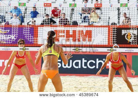 MOSCOW - JUNE 6: Athletes from USA look through net in Country Quota at tournament Grand Slam of beach volleyball 2012, on June 6, 2012 in Moscow, Russia.