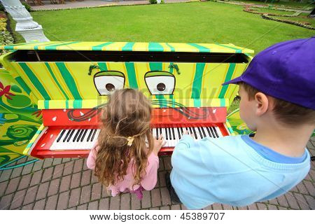 MOSCOW - JUNE 1: Children play piano at III Moscow Festival of puppets and game programs Long live game! in Hermitage Garden on Petrovka Street, on June 1, 2012 in Moscow, Russia.