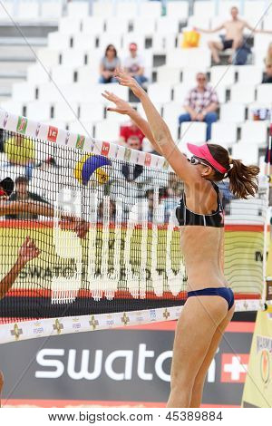 MOSCOW - JUNE 6: Athlete from Brazil threw ball over net at tournament Grand Slam of beach volleyball 2012, on June 6, 2012 in Moscow, Russia.