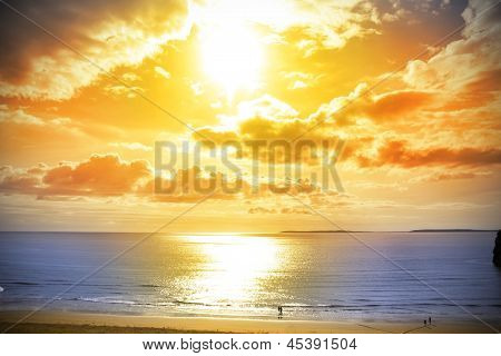 Tourists Walking On Ballybunion Beach At Sunset