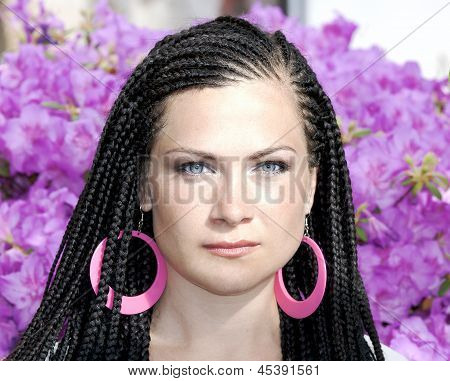 Woman with the african pigtails