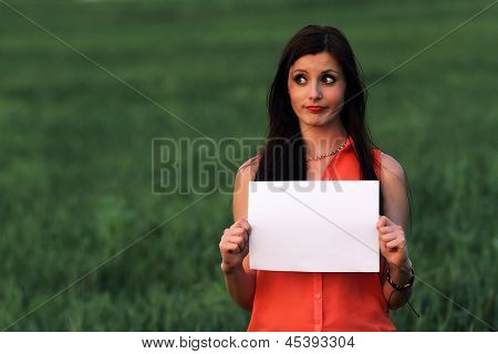 Young brunette beautiful  - pessimistic expression in the outdoors - space for text