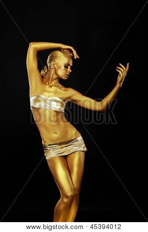 Radiance. Golden Statue. Gilded Woman's Body. Gold Bodyart