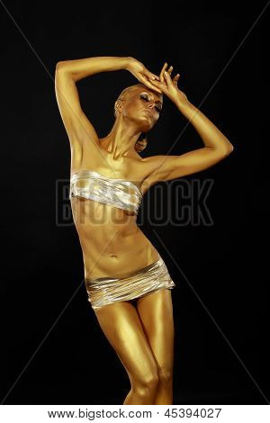 Body Art. Coloring. Graceful Woman With Shiny Gold Makeup In Reverie. Golden Statue
