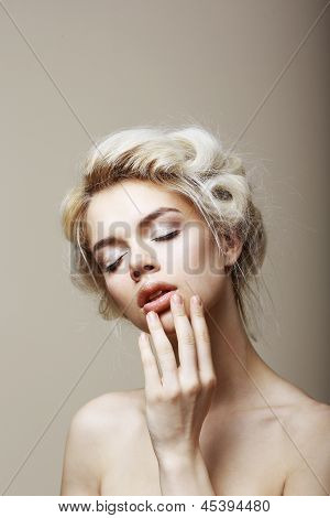 Purity. Sensual Romantic Blond Female With Closed Eyes Touching Her Face. Muse
