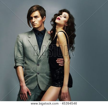 Young Well-dressed Couple In Elegant Fashion Clothes Hugging. Lifestyle