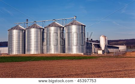 Silo In Beautiful Landscape In Sun