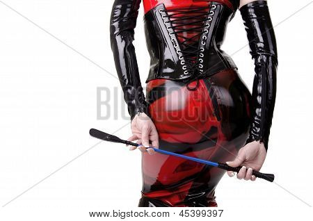 Woman dressed in dominatrix clothes