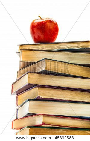 Stack Of Old Books With An Apple On Top