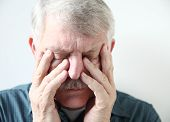 senior suffering from sinus pressure