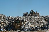 foto of landfill  - dozer and compactor working at landfill - JPG