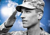 Soldier saluting on the blue sky background