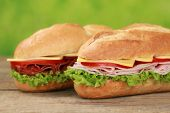 stock photo of salami  - Sub Sandwiches with salami ham cheese tomatoes and lettuce - JPG