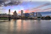 picture of portland oregon  - Portland Oregon Downtown City Skyline with Historic Hawthorne Bridge Across Willamette River at Sunset - JPG
