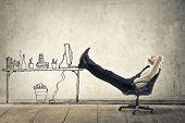 stock photo of leggings  - young businessman relaxes sitting in the office - JPG