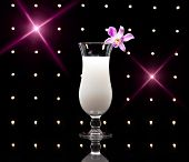 stock photo of pina-colada  - Pina Colada cocktail in front of disco lights - JPG