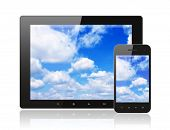 Tablet pc and smart phone with blue sky