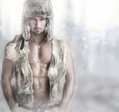 stock photo of vest  - Fashion portrait of a beautiful male model in fur hat and vest against modern background with copy space - JPG